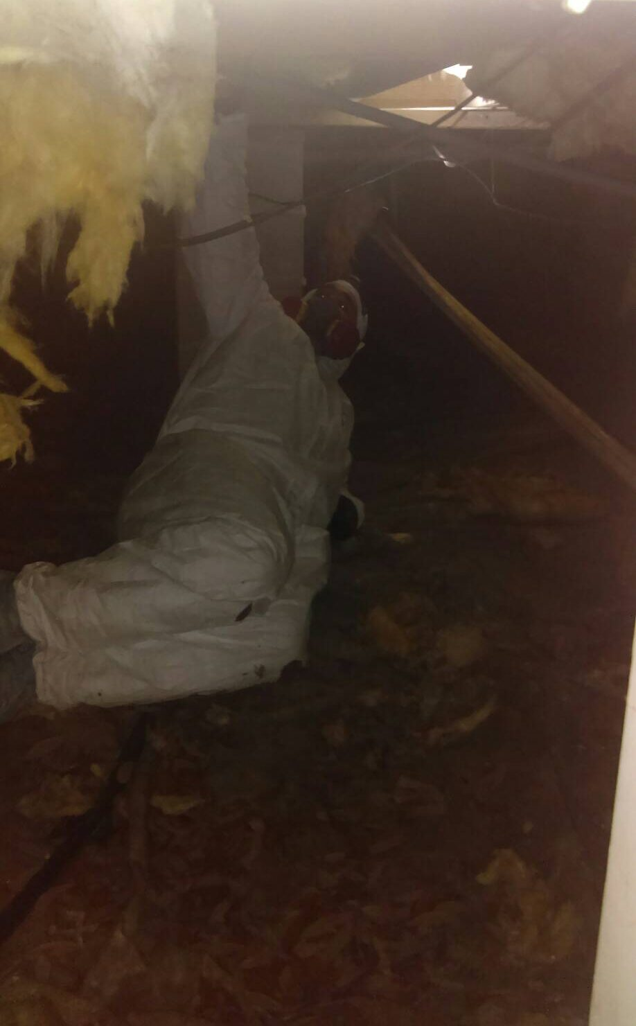 man installing installation under a house